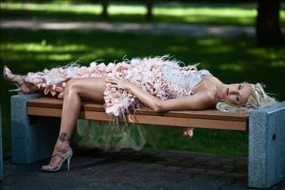 Sexy bride laying down on bench showing legs