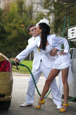 Sexy bride pumping gas