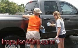 girl-and-mother-washing-truck