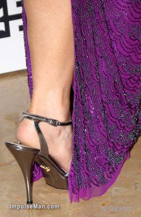 Penelope-Ann-Miller-purple-dress-leg-heel