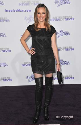melora-hardin-wearing-hot-hip-huger-boots